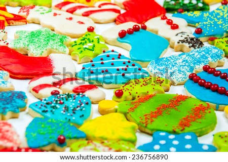 Iced and decorated Christmas cookies in pastel on a white background