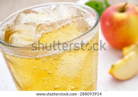 Iced apple juice spritzer - stock photo