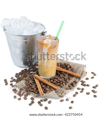 Iced brew coffee with milk on sackcloth, bucket with ice isolated on white background - stock photo