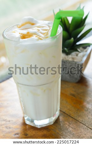 Iced Caramel Milk in the glass - stock photo