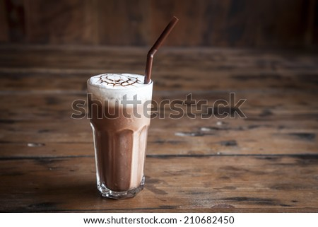 Iced chocolate on wood background - stock photo