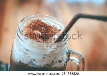 Iced chocolate on wooden table. - stock photo