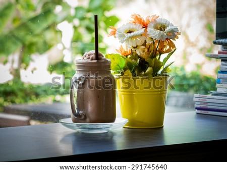 Iced chocolate smoothie On a wooden table. selective focus - stock photo