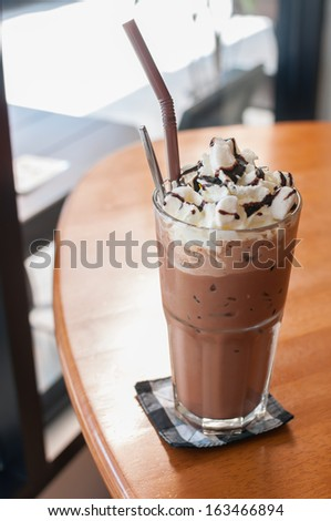 Iced cocoa and whipped cream topped with chocolate - stock photo