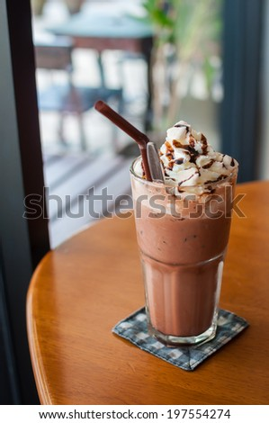 Iced cocoa and whipped cream topped with chocolate