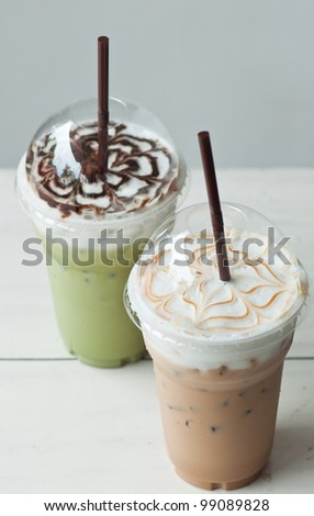iced coffee and iced green tea on table - stock photo