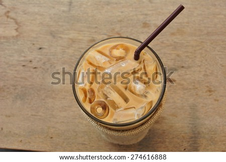 iced coffee and straw on wood table