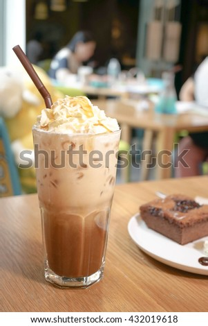 Iced coffee. Caramel Coffee. Caramel frappe coffee. With abstract background of a coffee shop - stock photo