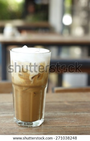 iced coffee, iced cappuccino on wooden table in summer time. - stock photo