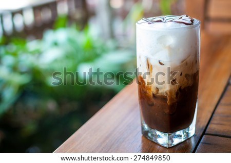 Iced coffee in a clear glass - stock photo