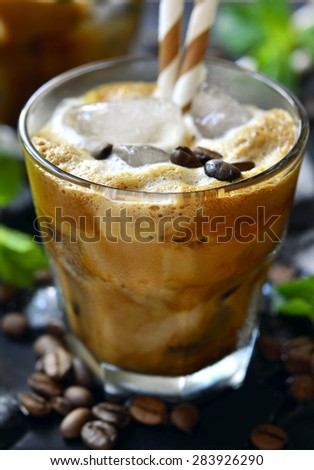 Iced coffee in a glass on black background. - stock photo