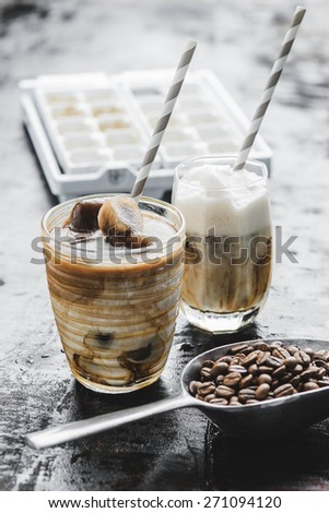 Iced coffee latte homemade making from ice cubes coffee frozen served with milk. Photo in vintage color tone style. - stock photo