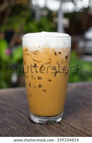 Iced coffee on a wooden table (Iced Cappuccino) - stock photo