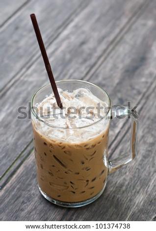 iced coffee on wood table - stock photo