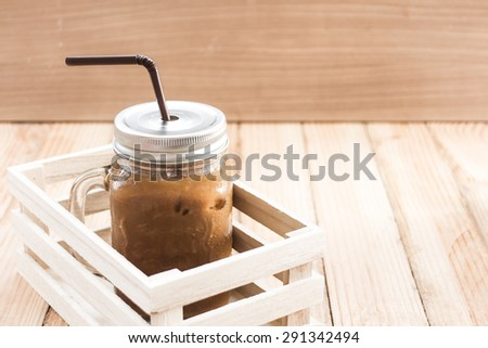 Iced coffee on wooden background