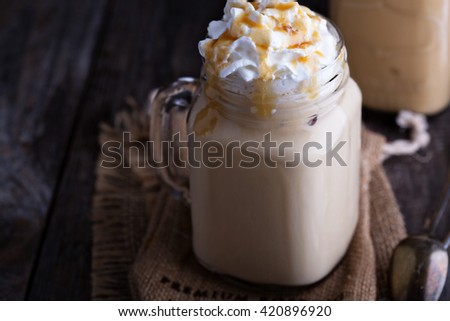 Iced coffee with caramel syrup and whipped cream - stock photo