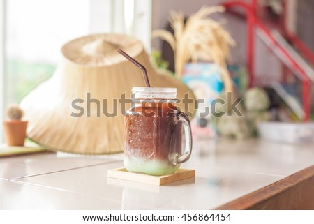 Iced coffee with milk  in a glass - stock photo