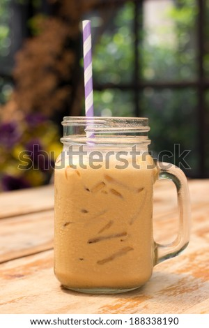 Iced coffee with milk is on the table. - stock photo