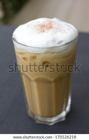 Iced coffee with soft cream on table. - stock photo