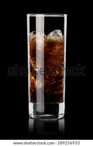 Iced cola in transparent glass on black background. Low key technique