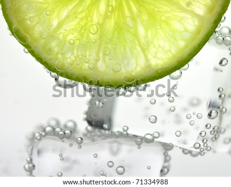 iced drink with lemon , close up - stock photo