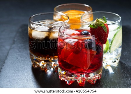 iced fruit drinks on a dark background, horizontal