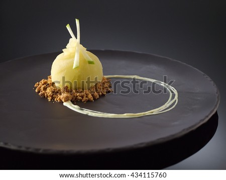 Iced granny smithapple crumble with calvados apple brandy - stock photo