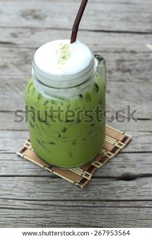 Iced green tea and milk is delicious - stock photo