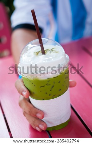 Iced Green tea in a cup - stock photo