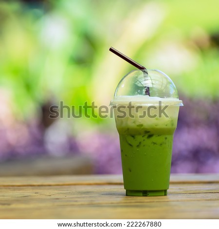 Iced green tea on a table in the summer with natural the background. - stock photo