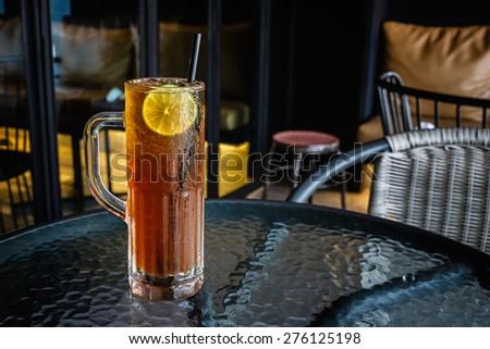 Iced lemon Tea on table in restaurant - stock photo