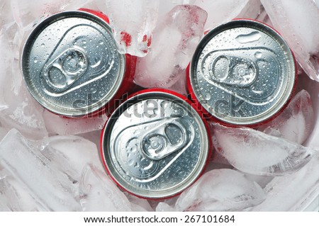 Iced metallic cans,  view from the top  - stock photo
