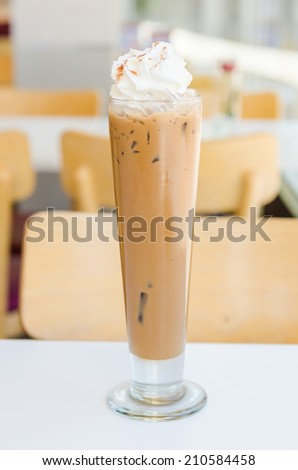 Iced mocha coffee with whip cream on top