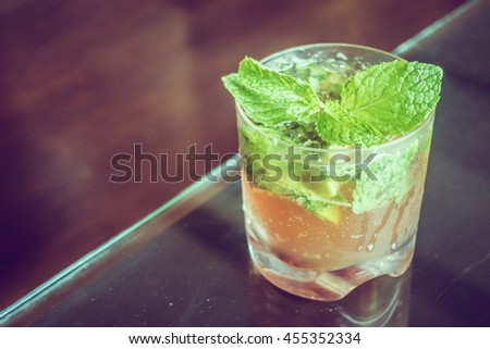 Iced Mocktail drink glass in restaurant - Vintage Filter