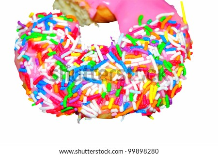 Iced pink donut with colourful sprinkles isolated on a white background using clipping path