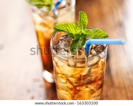iced sweet tea with blue straw - stock photo