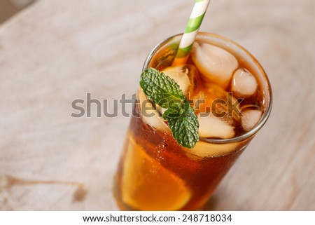 Iced sweet tea with lemon - stock photo