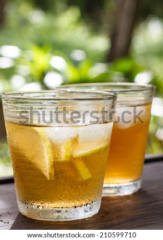 iced tea and lemon with nature background