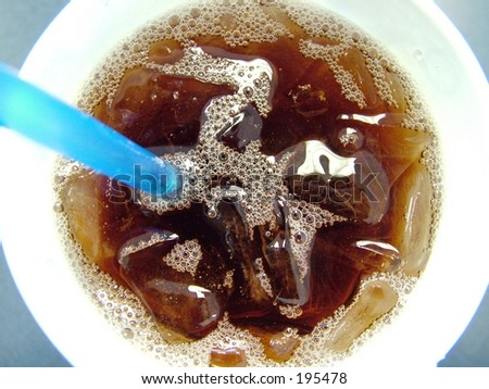 Iced tea drink in wax cup with straw - stock photo