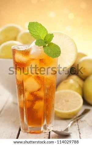 Iced Tea w Wild Lemons - Cooling Refreshments. Unsharpened file. - stock photo