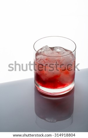 Iced tea with  ice cubes in a glas - stock photo