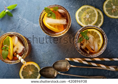 Iced tea with lemon and mint overhead shot - stock photo