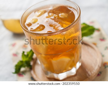 Iced tea with lemon slices, selective focus - stock photo