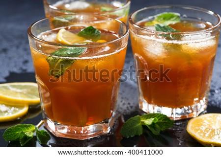 iced tea with mint and lemon, closeup, horizontal - stock photo