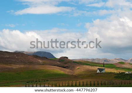 Iceland: a country church hidden by trees in the Icelandic landscape on August 16, 2012. The landscape of Iceland is worldwide considered unique and unlike anywhere else on the planet