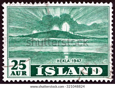 ICELAND - CIRCA 1948: A stamp printed in Iceland shows Mt. Hekla in Eruption, circa 1948. - stock photo