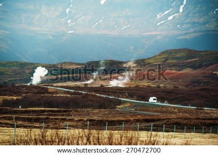 Iceland Geyser Thermal landscape steam road with bus  - stock photo