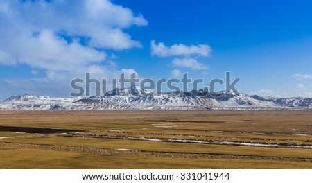 Iceland landscape of show mountain covered with clear blur sky - stock photo