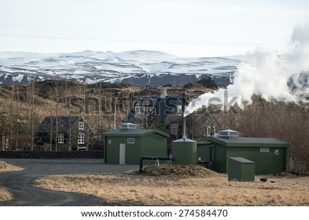 ICELAND - MARCH 25, 2015: A farm utilizes geothermal energy to generate electricity for domestic use. Non-polluting steam is released as a by-product and is environmental friendly. - stock photo