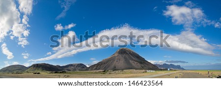 Iceland mountain cloudscape beautiful elongated clouds over Icelandic hills a sunny blue sky summers day picturing the ring road scenic tourism paradise travel landscape clouds formation meteorology